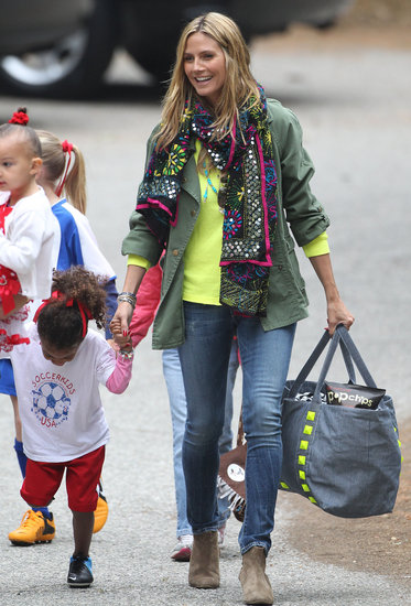 Heidi Klum livened up her army green jacket with an exotic, multicolored scarf in LA.