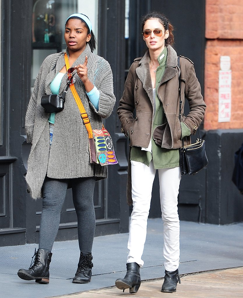 Nicole Trunfio worked a pair of white jeans in a fresh new way during a  day out in NYC: with an army-green blouse and a brown shearling coat.