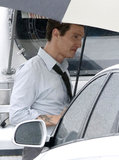 Matthew McConaughey huddled under an umbrella while on set in New Orleans on Monday.