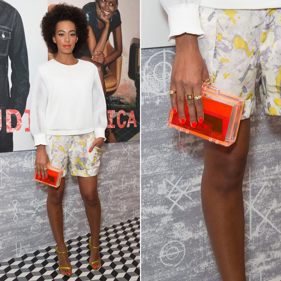 Solange Knowles also owns CCSkye's neon orange Lucite clutch and carried it with printed shorts and a white sweater at the Diesel + Edun party in LA.