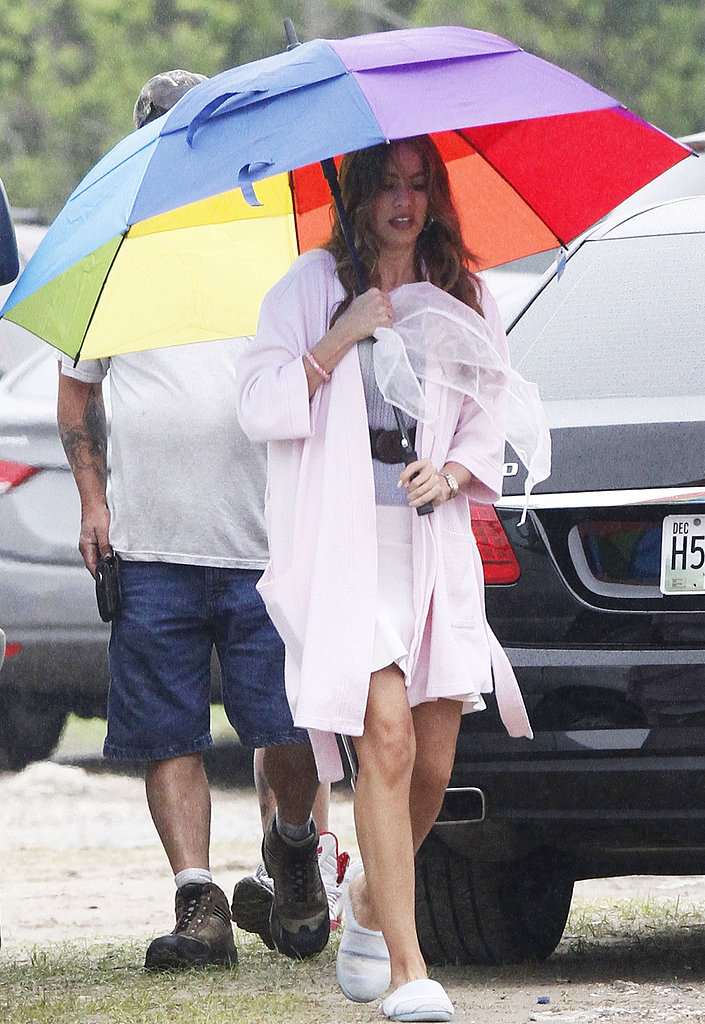 Sofia Vergara tried to keep out of the New Orleans rain while on the set of Heat on Monday.