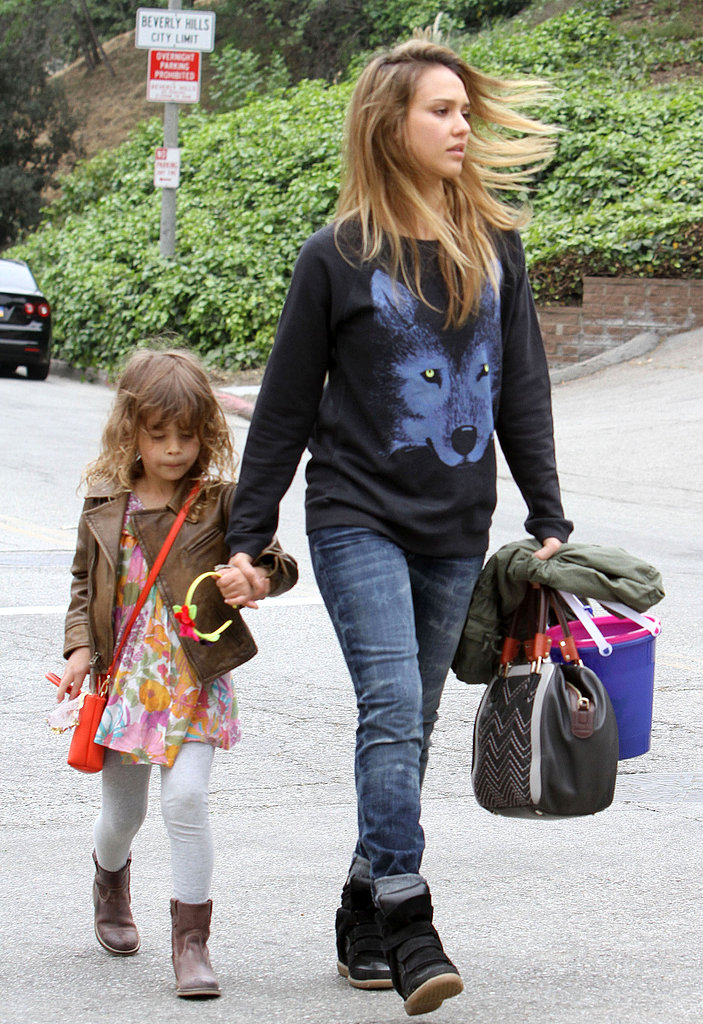 "Jessica showed off her wild side in a wolf-print sweater, Current/Elliott ""The Rolled"" jeans, and Isabel Marant sneakers with daughter Honor in Beverly Hills."