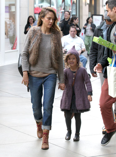 Jessica Alba cozied up in a oatmeal sweater, cropped fur vest, and cuffed boyfriend jeans while taking Honor to a birthday party at Century City mall in LA. The actress completed her Fall-friendly style with contrast-lace boots, a black leather backpack, and gold cross earrings