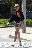 Diane Kruger wore a blue sweater and denim cutoffs.