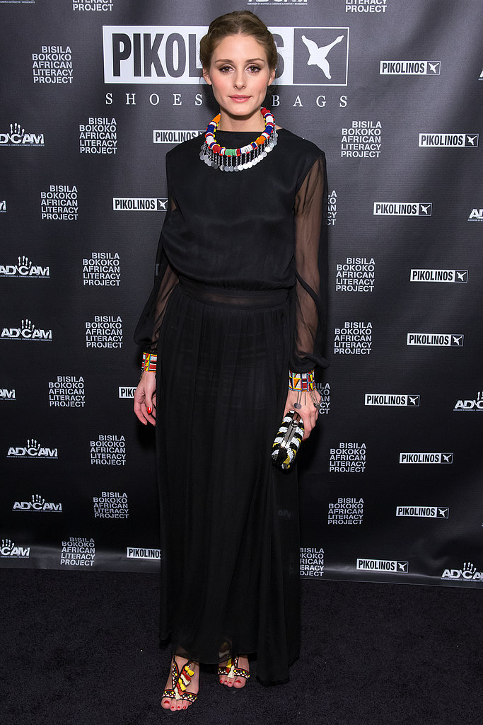 Olivia Palermo attended the Pikolinos Gala Dinner in a black, sheer-sleeved Frank Tell dress and Christian Louboutin heels, but it's the addition of her beaded necklaces and Zara clutch that made all the difference in this ensemble.