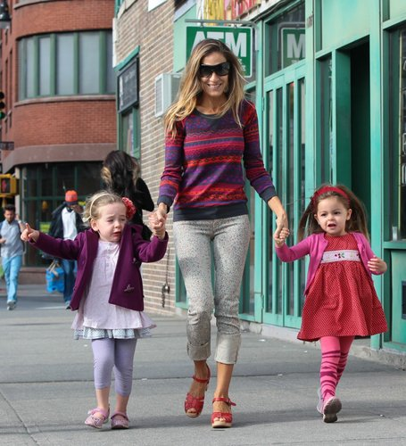 Sarah Jessica Parker took her twin daughters on a stroll in NYC and mixed prints in a colorful fair isle sweater and dotted jeans, which she cuffed at the bottom for dramatic flair.