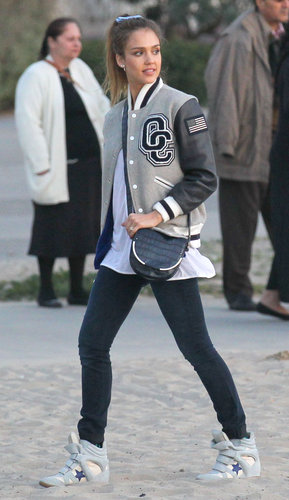 Get sporty-chic inspiration from Jessica's park date style: an Opening Ceremony varsity jacket, wedge Isabel Marant sneakers, and a navy Vince Camuto crossbody. And of course, a pair of perfectly sleek boyfriend jeans.