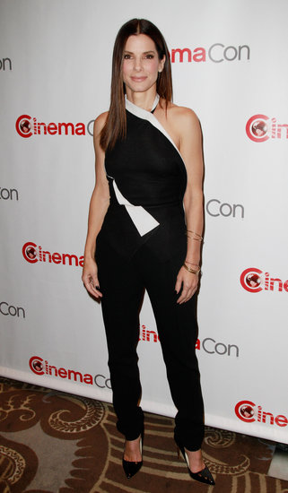 Sandra Bullock made a very chic appearance at CinemaCon in Las Vegas wearing a black-and-white one-shouldered jumpsuit and black Rupert Sanderson patent pumps.