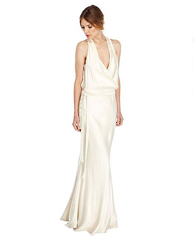 A cowl neckline offers a dramatic touch to this Nicole Miller Clara gown ($1,100), but the easy silhouette feels uncomplicated, so you won't look overdone at a beachy ceremony.