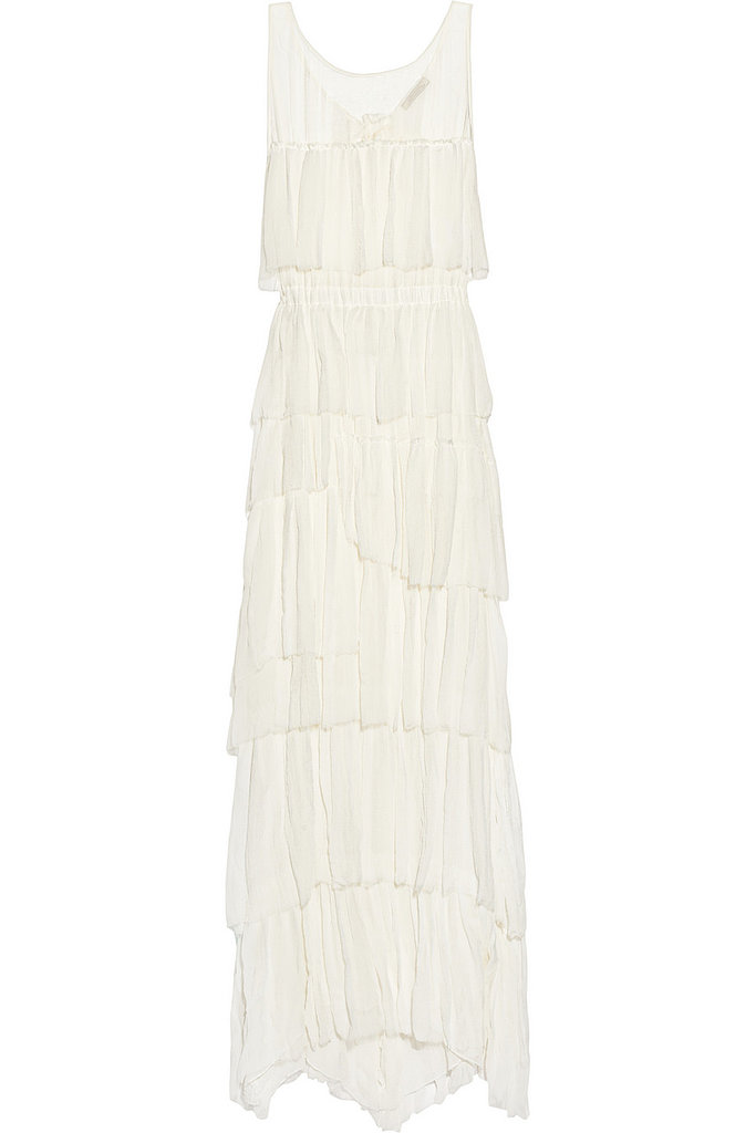 The neckline and delicate lace layers are all romance on this Nina Ricci tiered gown ($3,350), but the hem is just the right length to avoid dragging in the sand.