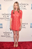 Mira Sorvino kept it short and sweet in a red lace minidress and gold sandals at the Mistaken For Strangers premiere.