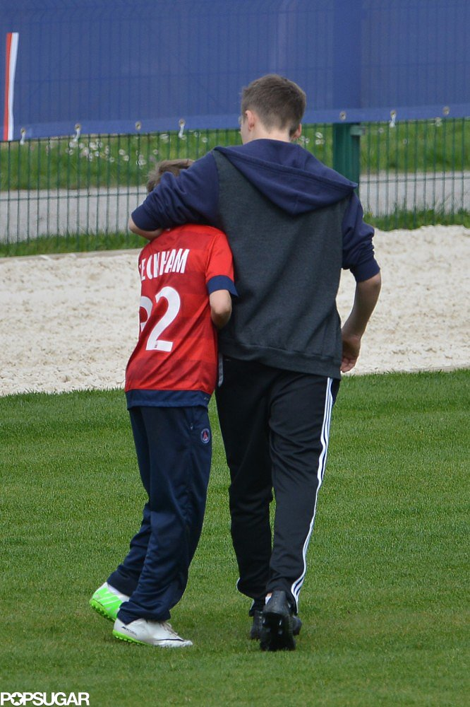 Brooklyn and Romeo Beckham hugged on the field while training with Paris Saint-Germain.