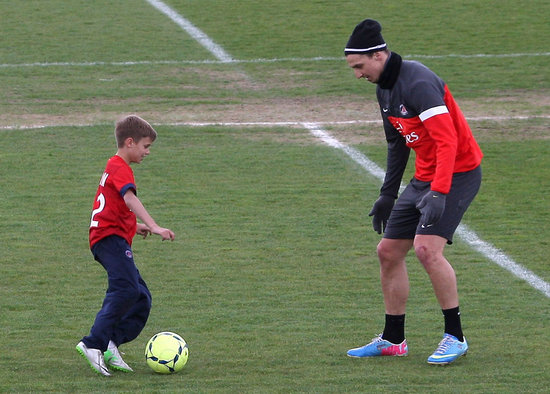 Romeo Beckham took on Paris Saint-Germain striker Zlatan Ibrahimović on the field.
