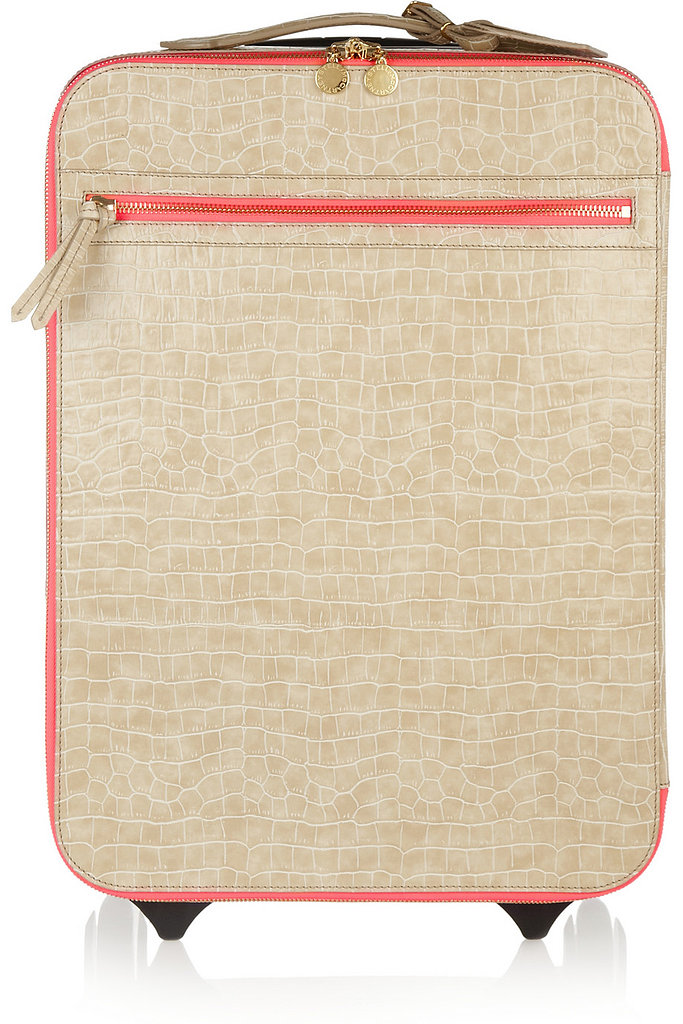 Now that we've covered your perfect vacation, you can stash it all in Stella McCartney's Faux Crocodile Suitcase ($1,880). Bon voyage!