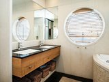 A large window and double mirrors give the bathroom an open, airy feel. Source: Sotheby's