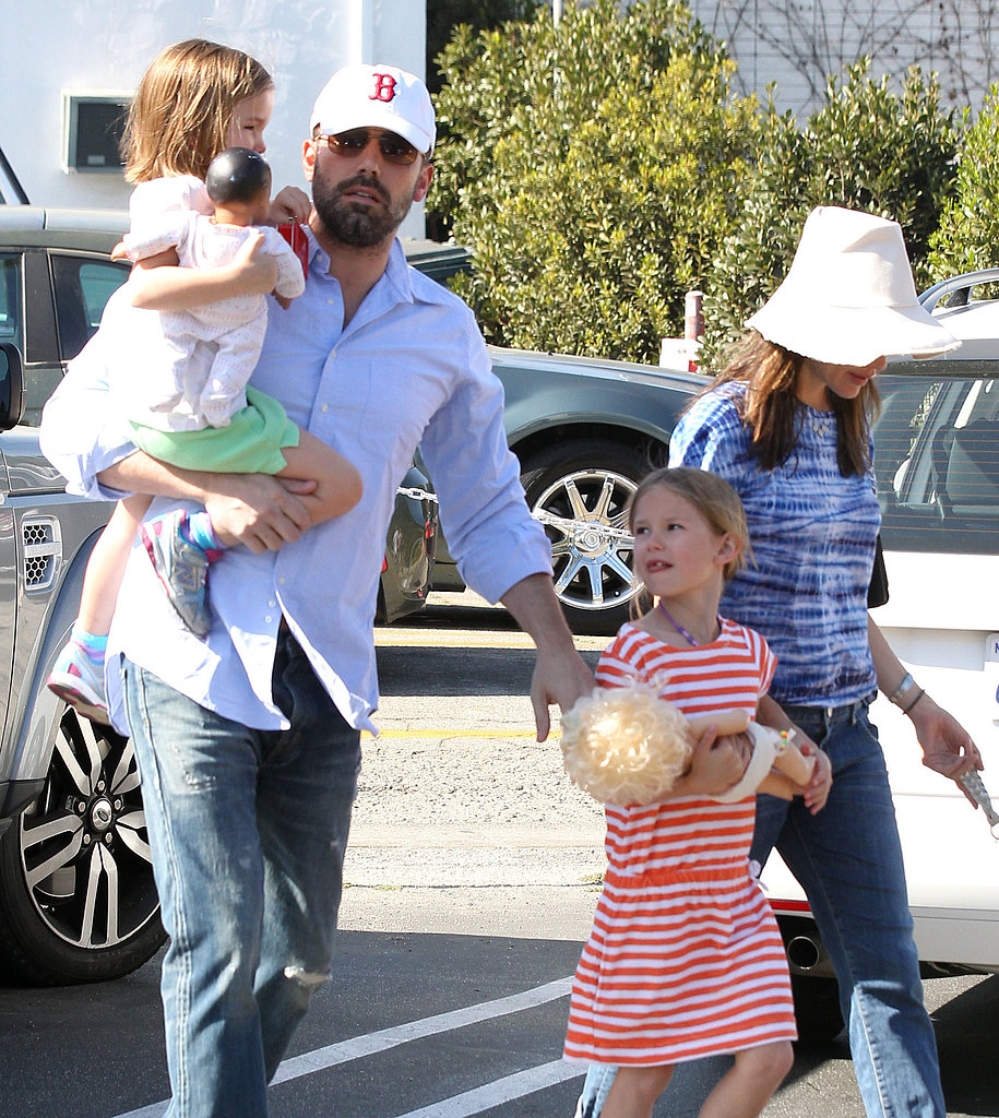 Ben Affleck held onto his girls, Violet and Seraphina, while out in LA at the Brentwood Country Mart.