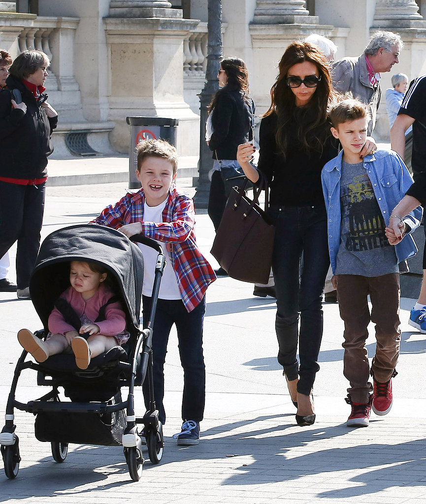 Victoria Beckham took her family to the Louvre Museum in Paris where Cruz helped the mom of four out by pushing Harper in her stroller.