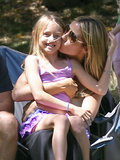Heidi Klum planted a kiss on her daughter Leni Samuel while on the sidelines at her kids' soccer game in LA.