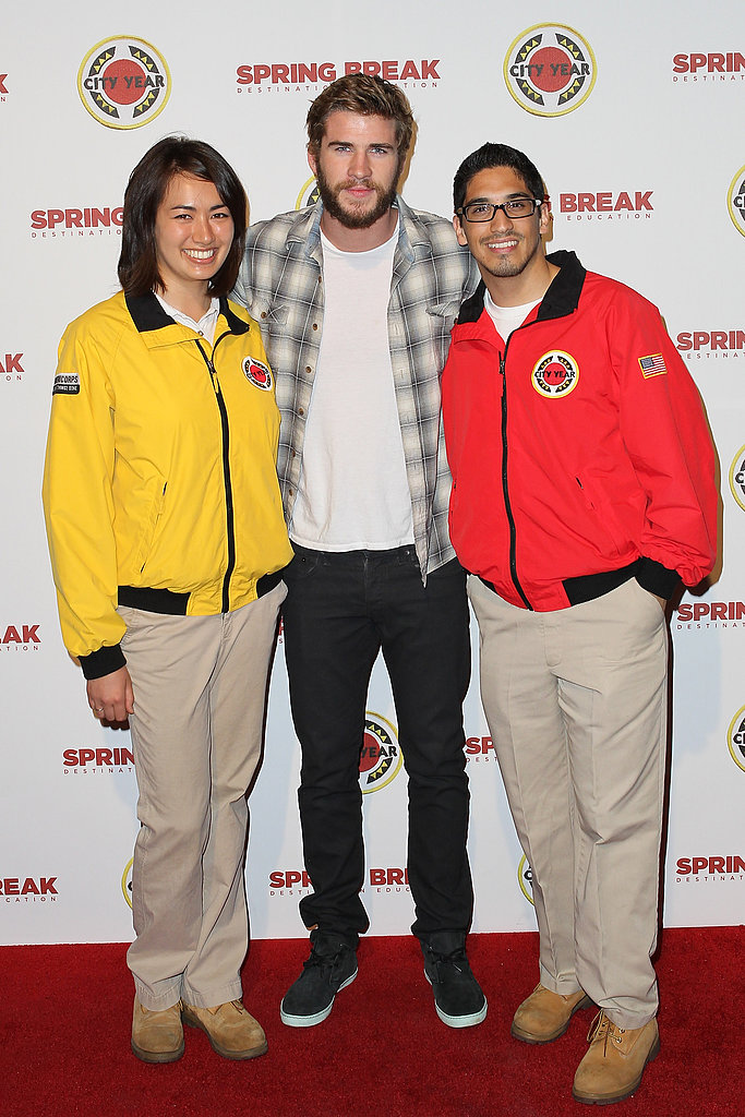 Liam Hemsworth stopped on the Spring Break: Destination Education red carpet to pose with AmeriCorps members.