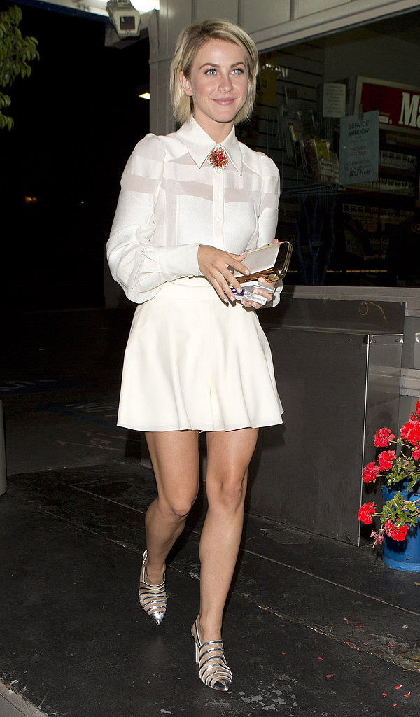Julianne Hough appeared polished in a sheer white blouse flirty white skirt, both by Carolina Herrera, silver metallic striped pumps, and a red brooch during a night out in LA.
