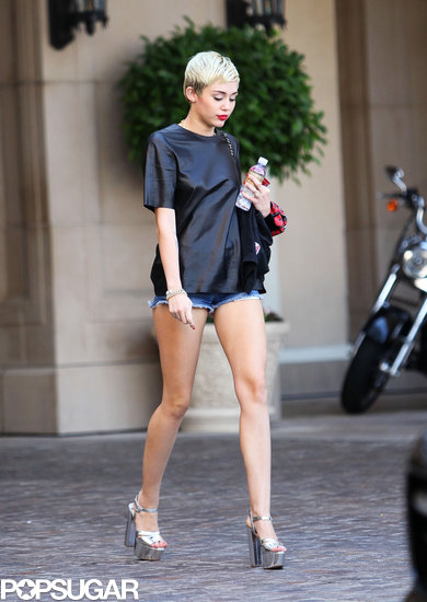 Miley Cyrus showed off her legs — and her engagement ring — during an outing in Beverly Hills, CA.