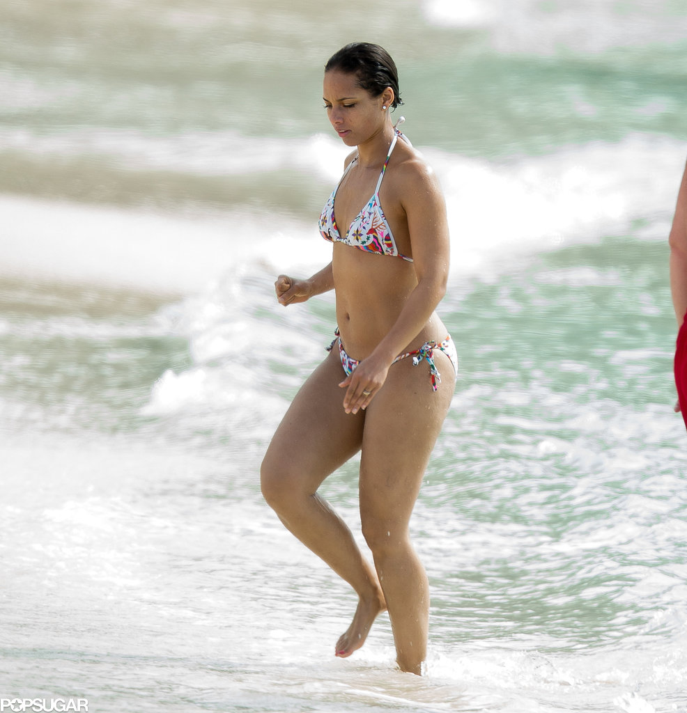 Alicia Keys donned a bikini for a dip in the water while vacationing in the Bahamas.