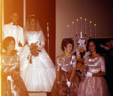 The bridesmaids seemed to enjoy their shiny ensembles in 1962.  Source: Flickr user Tomfryer