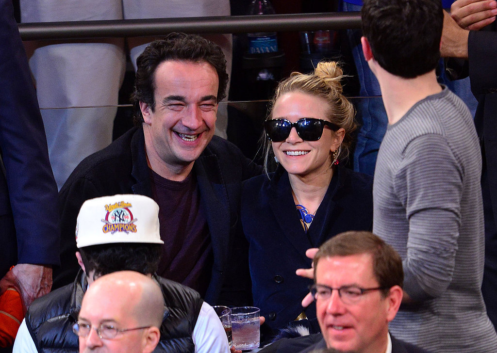 Mary-Kate Olsen and Olivier Sarkozy smiled and laughed together during the game.
