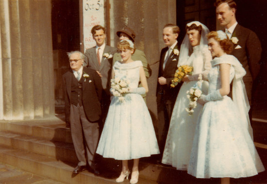 The tea-length, soft-blue bridesmaids dresses were quite glamourous at this 1950 marriage.  Source: Flickr user Vintage Women