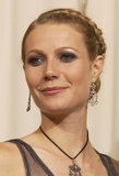 At the 2002 Oscars, Gwyneth Paltrow went slightly goth with a purple-tinged smoky eye and a braided bun hairstyle.