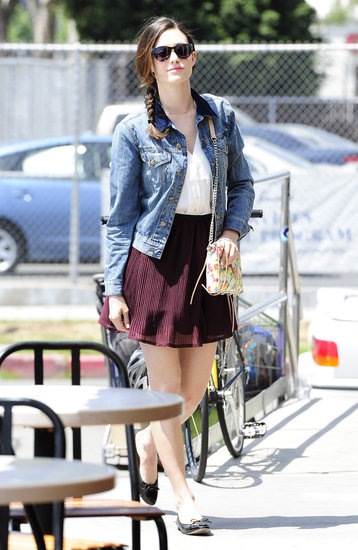 We love how Emmy Rossum's denim jacket lent laid-back flair to her flirty accordion-pleated skirt and floral Rebecca Minkoff bag in LA.