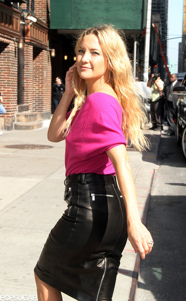 Kate Hudson held her hair back as she walked into her next interview amid promoting The Reluctant Fundamentalist.