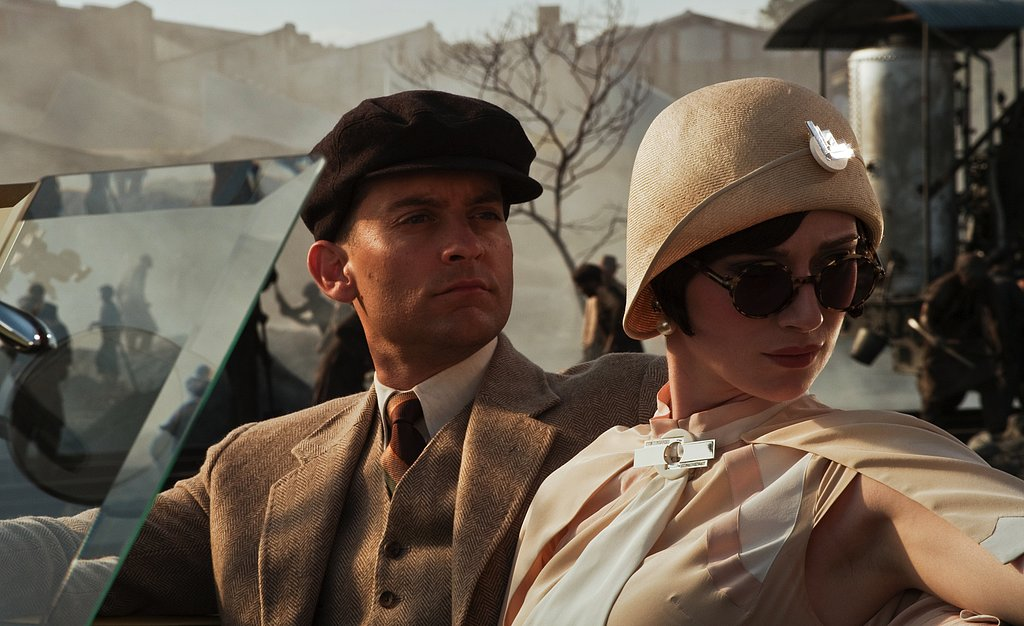 Tobey Maguire as Nick Carraway and Elizabeth Debicki as Jordan Baker in The Great Gatsby.