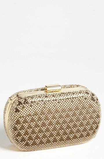 This Whiting & Davis Art Deco Clutch ($198) makes it easy to get your hands on the era's fashion.