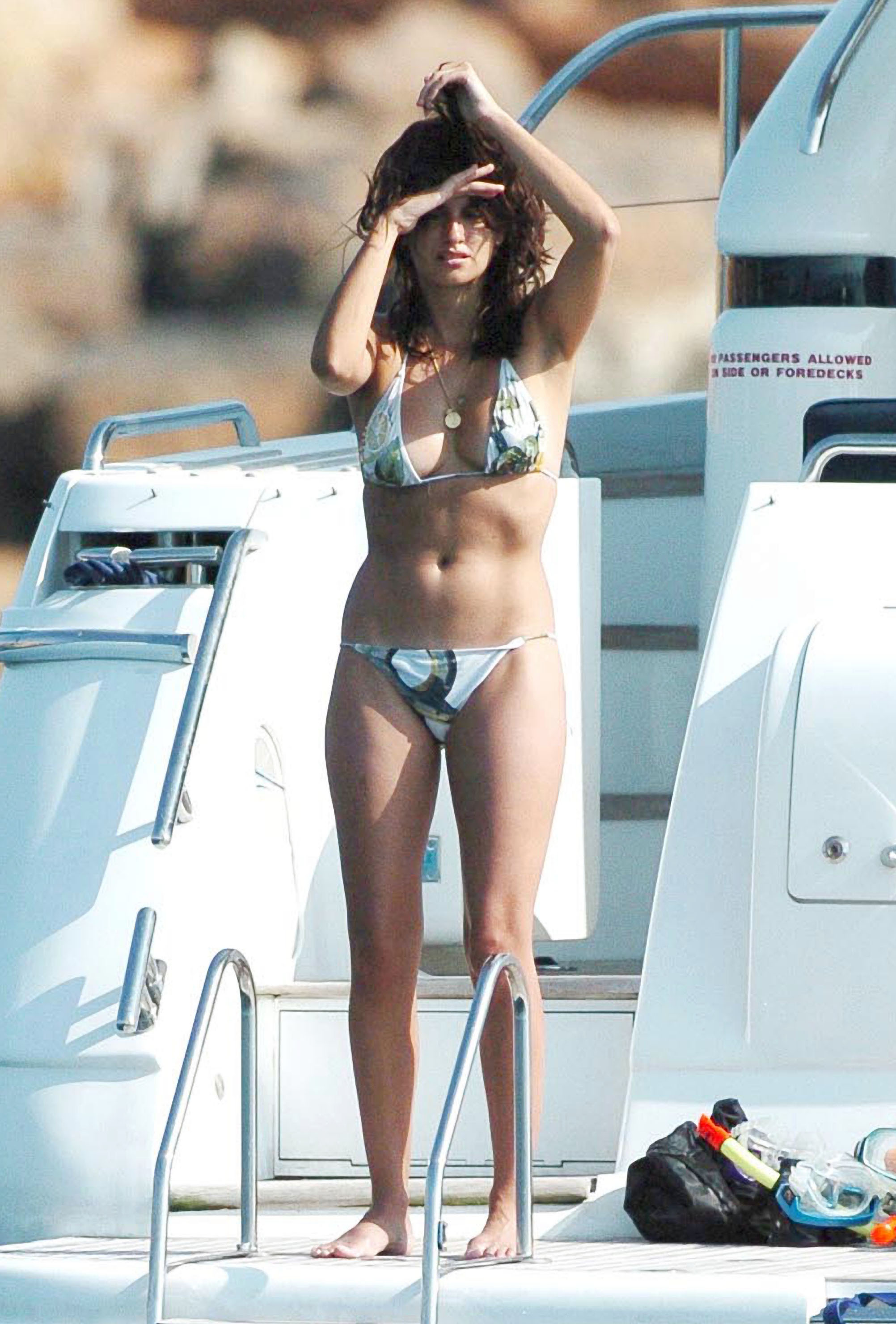 Penélope Cruz shaded her face from the sun while lounging on a yacht during an August 2006 trip to Ibiza.