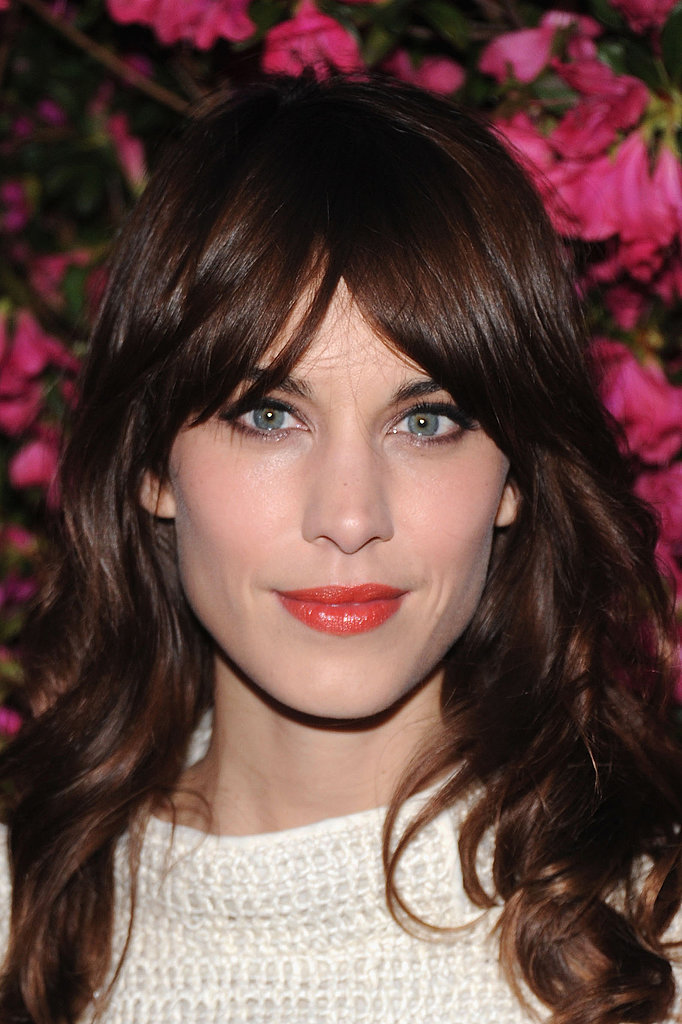 Alexa Chung's long fringe and dusty coral lips
