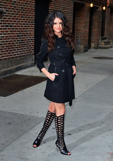 Selena gave a simple black Burberry Gabardine trench coat ($1,395) a huge shot of S&M-chic with a pair of knee-high Brian Atwood Electra leather boots ($1,750). Selena's shoe game is definitely taking a sultrier turn these days.
