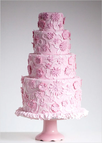 This cake, full of flowers, frills, and delicate details, has all the makings of a traditional cake —except it's all pink and was modeled after a Chanel dress.  Photo by Sugar Ruffles via Wedding Chicks