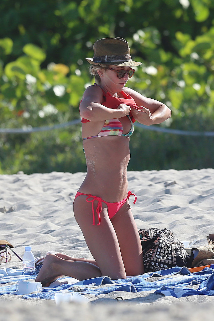 Julianne Hough got dressed at the beach in Miami in April 2013.