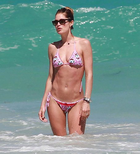 Doutzen Kroes wore a pink bikini while splashing around in Miami in April 2013.