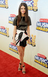 At the 2013 Radio Disney Music Awards in LA, Selena Gomez revealed her fashion know-how when she juxtaposed a tough black leather tee with a feminine, printed, tulip-shaped Blumarine miniskirt from the Fall '13 collection. With such an eye-catching pairing up top, Selena knew to keep her footwear minimalistic, albeit chic.