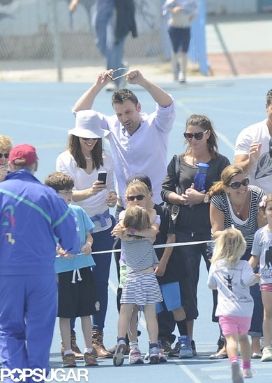 Ben Affleck, Jennifer Garner, and Violet Affleck cheered on Seraphina as she crossed the finish line at her track meet on Sunday in Pacific Palisades, CA.