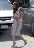 The purple-and-gray knee-length Elie Saab dress Eva Longoria donned in LA would delight any bridal-shower crowd. The nude pumps and envelope clutch were fitting too.