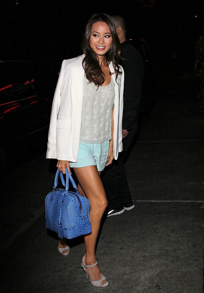 Jamie Chung hit the town in a pair of mint shorts, a white blazer, and a blue embossed Alice + Olivia bag.