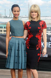 A closer look at the co-stars' knee-length cocktail dresses. Zoe Saldana chose a Calvin Klein A/W '13 look, while Alice Eve went with something from Reem Acra's A/W '13 collection.