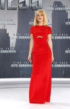 Alice Eve chose a stunning red Emilio Pucci gown — complete with subtle midriff cut-out — for the Berlin premiere of Star Trek Into Darkness. While you may not be able to see them here, the blonde actress also wore Rene Caovilla shoes with the look.