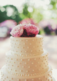 Does it get any simpler or more timeless than this? Beading and pink peonies are the two ingredients it takes to get the look of this stunning cake.  Photo by Kristen Marie Photography via Style Me Pretty
