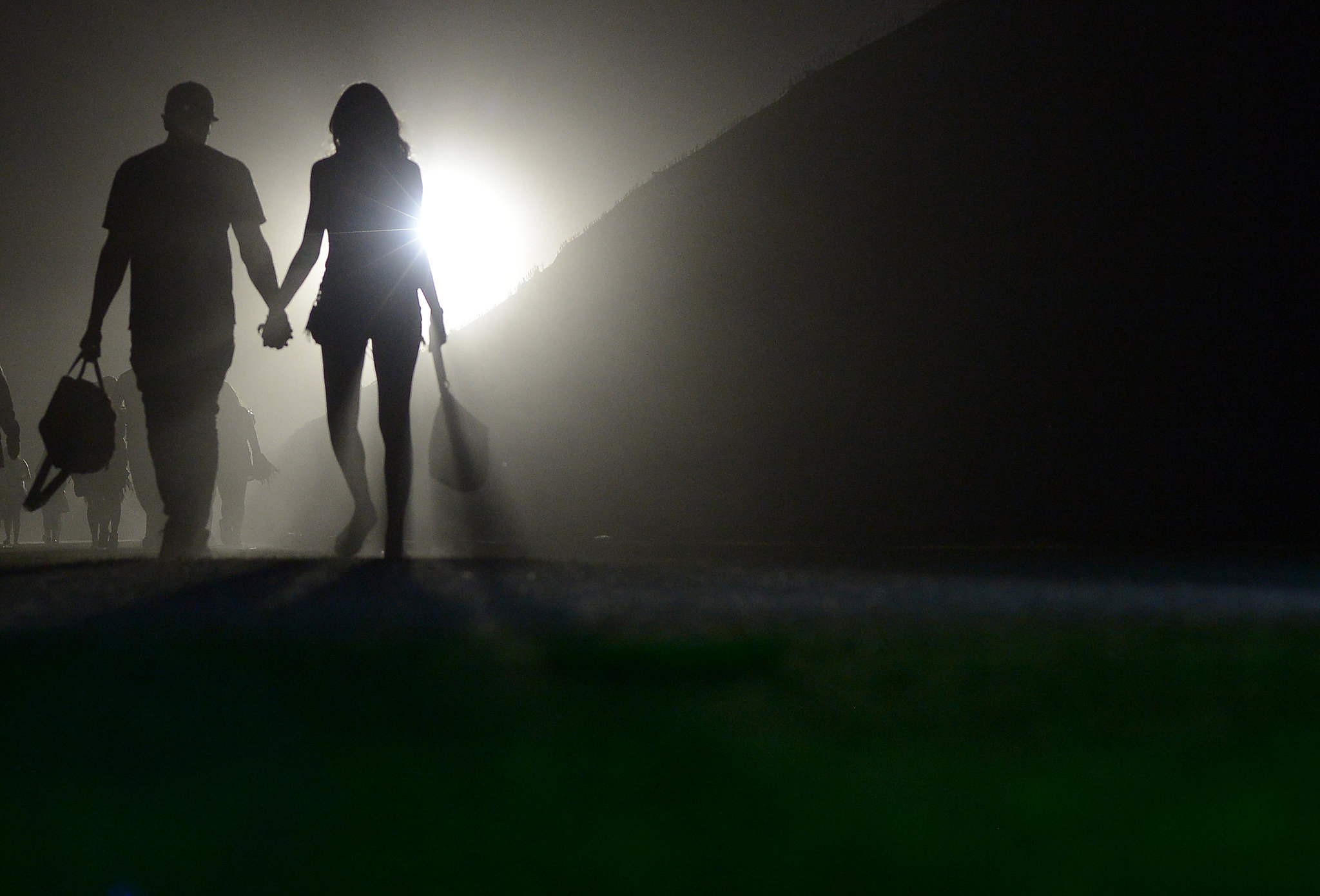 A couple walked hand in hand at Coachella.