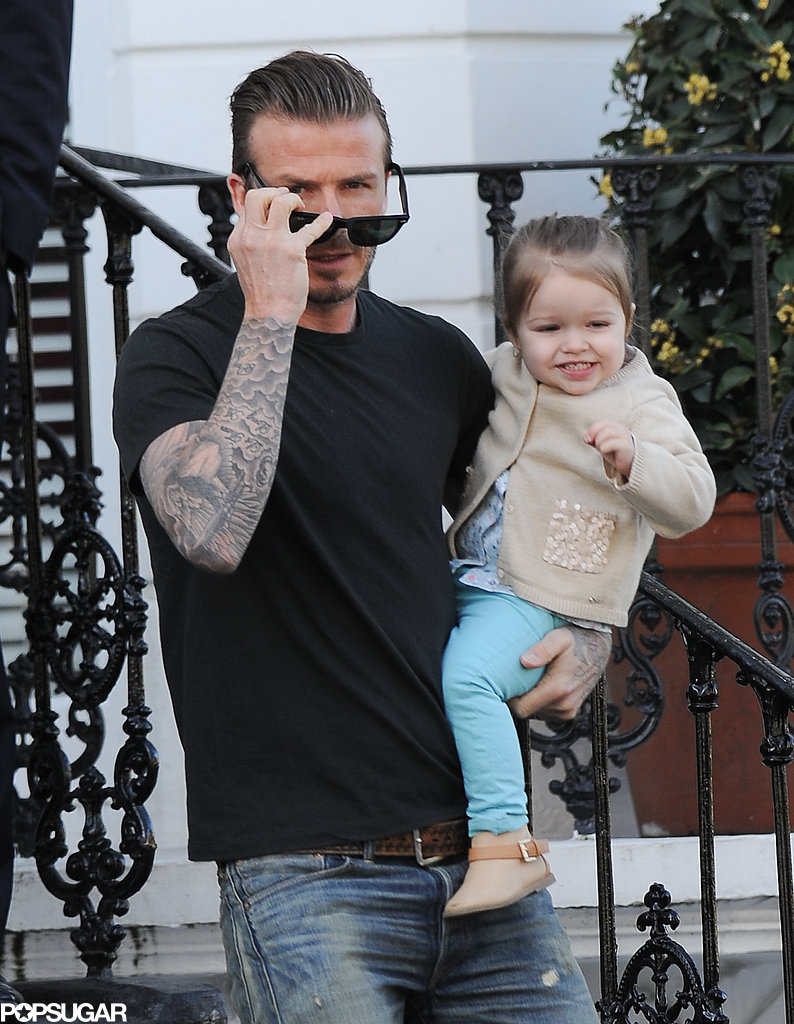 David Beckham held Harper during a morning stroll.