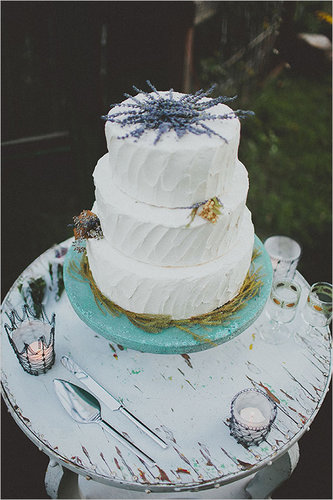 With lavender peeking out from the top, this charming white cake has all the potential to steal the show.  Photo by Blue Vinyl Creative via Wedding Chicks